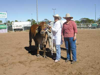 Anne Britton, Goodwood Station, Boulia sashed the Junior Champion Female, Palmvale Miss Pablo 2141 being held by Beth Streeter